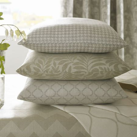 Ashley Wilde -  Coastal Fabric Collection - Cream zigzag fabric with cream and white wavy line print fabric, with a stack of three patterned cream and white fabric cushions