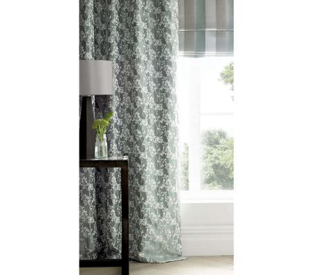 Ashley Wilde -  Coniston Fabric Collection - Green curtains decorated with a pattern of white flowers and a roman blind featuring modern stripe pattern