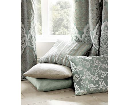 Ashley Wilde -  Coniston Fabric Collection - Green curtains featuring luxurious pattern in white and gold and elegant decorations on silky cushions