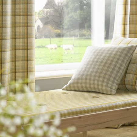Ashley Wilde -  Edderton Fabric Collection - Wood bench seat with yellow, grey and white checked seat cushion, with coordinating checked curtains, and a grey checked cushion