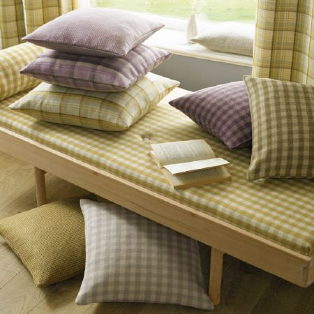 Ashley Wilde -  Edderton Fabric Collection - Pale wood bench with seat and scatter cushions in variations of mustard yellow, grey, white and mauve checks, with checked curtains