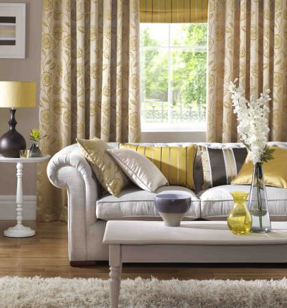 Ashley Wilde -  Edina Fabric Collection - Beige curtain featuring chic floral pattern in yellow and a collection of cushions featuring stripe and floral designs