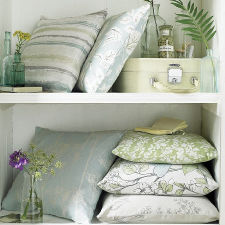 Ashley Wilde -  Fleur Fabric Collection - 3 different green and white floral designed cushions, 2 blue and white floral cushions, 1 striped cushion, cream travel case, glass bottles