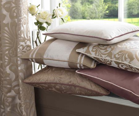 Ashley Wilde -  Imporo Fabric Collection - Plain white and dark purple cushion, beige cushion with silky floral pattern and beige cushion with white floral pattern