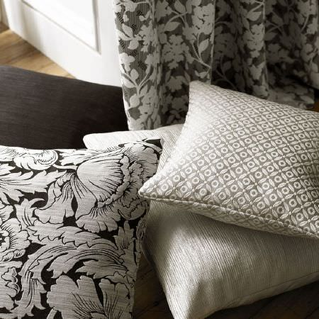 Ashley Wilde -  Kensington Fabric Collection - Light grey, white and black cushions featuring several different designs, with floral curtains in light, mid and dark grey
