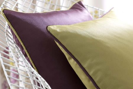 Ashley Wilde -  Liberty Fabric Collection - Elegant cushion in soft shade of green with purple edges and purple cushion with green edges