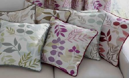 Ashley Wilde -  Linden Fabric Collection - Selection of cream cushions with purple and green modern leaf prints and coloured piping