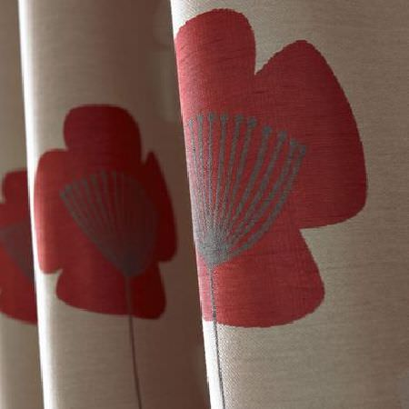Ashley Wilde -  Loretta Fabric Collection - Close-up photo of a modern simple flower design in red on a sandy coloured curtain