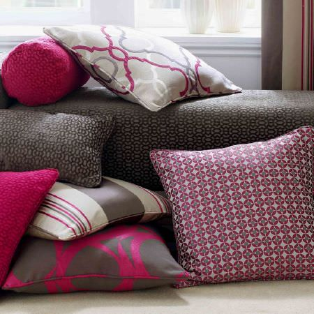 Ashley Wilde -  Malone Fabric Collection - A grey upholstered bench with a modern style pattern, and square pillows with purple dots and stripes, and plain purple cushions