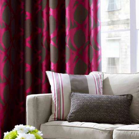 Ashley Wilde -  Malone Fabric Collection - Dark purple curtains with a modern pink stroke pattern behind a classic white upholstered couch with a plain grey and a pink striped cushion