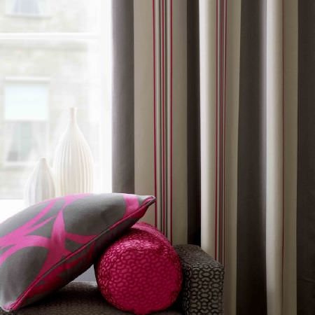 Ashley Wilde -  Malone Fabric Collection - A grey upholstered bench with a modern pattern with a cylindrical and square cushion, and a sandy pink striped curtains for a modern house