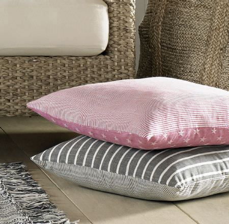 Ashley Wilde -  Newport Fabric Collection - A pink cushion and a grey cushion, with thin stripes on one side and wider stripes or a pattern on the other side