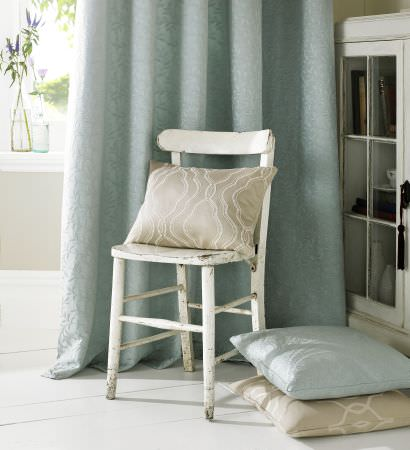Ashley Wilde -  Oldbury Fabric Collection - A distressed wood chair with fabrics made in pale blue and grey, made into plain and patterned cushions and curtains