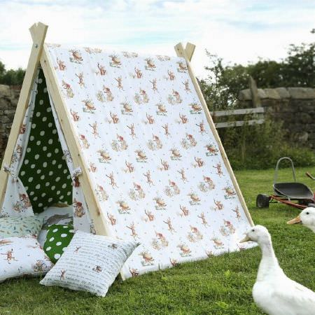 Ashley Wilde -  Roald Dahl Fabric Collection - Wood tent draped with white fabric covered with fun characters and lined with green fabric with white polka dots, with matching cushions