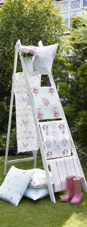 Ashley Wilde -  Thornbury Fabric Collection - Fabric decorated with flowers and bird houses from the Thornbury fabric collection on a ladder, and cushions made from that fabric