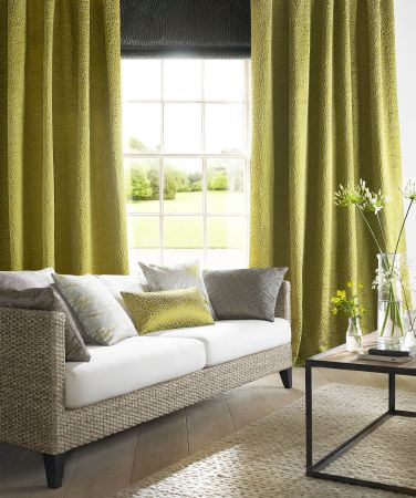 Ashley Wilde -  Wayland Fabric Collection - Vibrant yellow curtains and a collection of white, grey and silver cushions with simple decorations
