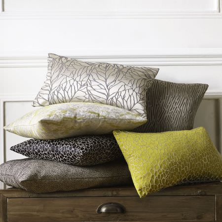 Ashley Wilde -  Wayland Fabric Collection - Yellow, beige, black, silver and grey cushions featuring creative threaded shiny decorations