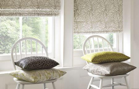 Ashley Wilde -  Wayland Fabric Collection - White roman blinds featuring modern pattern in beige and a collection of modern decorative cushions