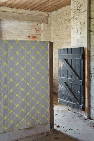 Barneby Gates -  Barneby Gates Fabric Collection - Light grey fabric decorated with an abstract yellow chequered pattern from the Barneby Gates Fabric Collection