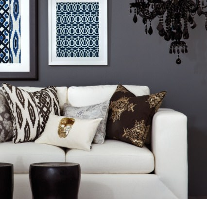 Beacon Hill -  Ankasa Iconic Fabric Collection - White sofa with patterned cushions in brown, gold, grey, black and white, with a black chandelier and occasional tables