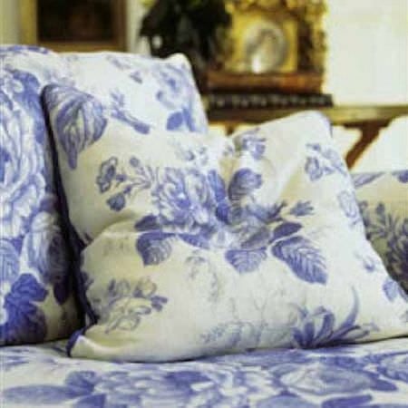 Blithfield -  Collection I Fabric Collection - Vintage inspired navy blue and chalk white floral patterned cushions on a matching sofa
