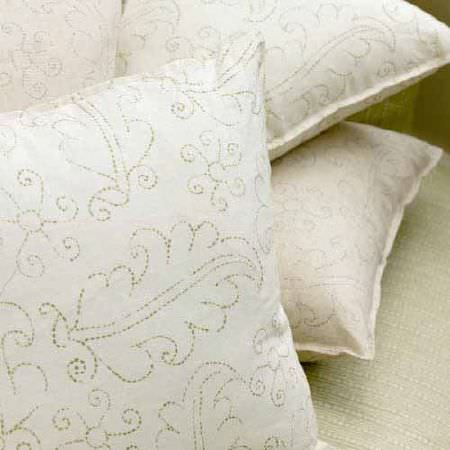 Blithfield -  Collection III Fabric Collection - Delicate swirling leaf patterns created with dotted lines, printed on four plain white square scatter cushions