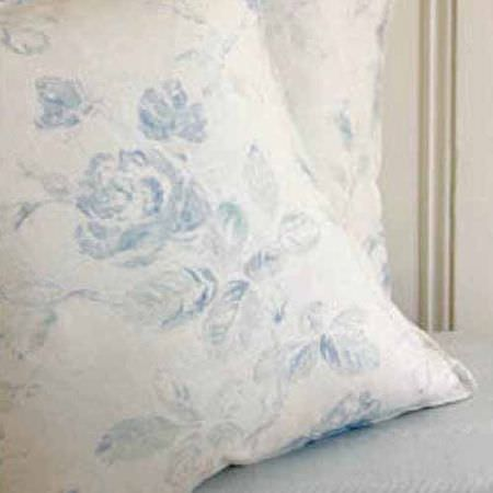 Blithfield -  Collection III Fabric Collection - Pale blue fabric beneath two square scatter cushions with vintage style florals printed in baby blue on white fabric