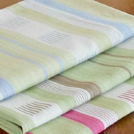 Blithfield -  Collection IV Fabric Collection - Three neat folds of striped fabric, with designs in sky blue, chocolate brown, strawberry pink, white and grey-green