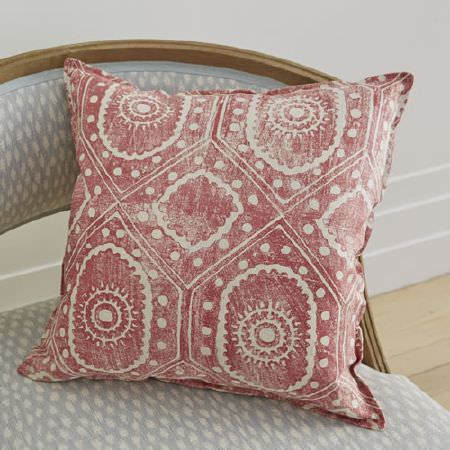 Blithfield -  Peggy Angus Fabric Collection - A red and white patterned scatter cushion on a wooden framed armchair covered with pale blue and white patterned fabric