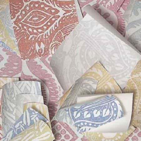 Blithfield -  Peggy Angus Fabric Collection - A scattered pile of swatches of fabric featuring white, pink, grey, green, blue and red stylised leaf designs and patterns