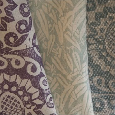 Blithfield -  Peggy Angus Fabric Collection - Three fabrics with stylised designs: purple and white florals, green and white leaves, and blue and white patterns