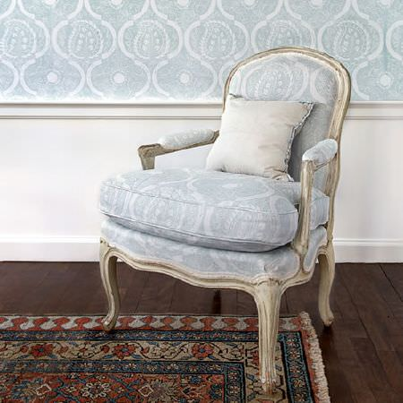 Blithfield -  Peggy Angus Fabric Collection - White painted wooden framed armchair with pale blue and white patterned cushions, matching wall coverings and a dark rug