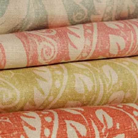 Blithfield -  Peggy Angus Fabric Collection - Cream, paprika, green-gold, raspberry and duck egg blue coloured patterns on four neat folds of fabric