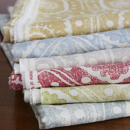 Blithfield -  Peggy Angus Fabric Collection - Blue, green, red, grey and gold patterns printed in distressed designs on a stack of six different white fabrics