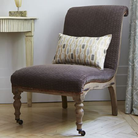 Blithfield -  Somerton Fabric Collection - Curved wooden chair painted in brown-grey, covered with dark grey fabric, with a patterned grey, brown and white cushion