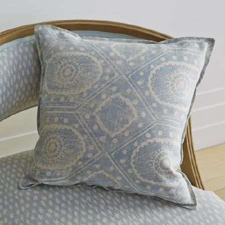 Blithfield -  Somerton Fabric Collection - A wooden framed armchair and a square scatter cushion covered with two different pale blue and white patterned fabrics
