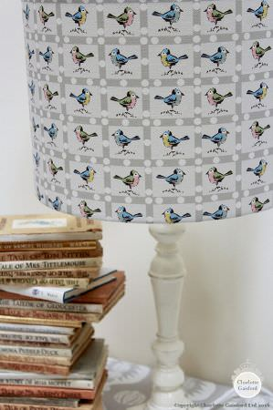 Charlotte Gaisford -  Nursery Fabric Collection - Lamp featuring light grey background and a pattern of colourful birds inside small white squares