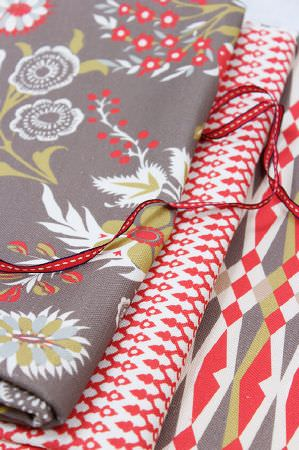 Charlotte Gaisford -  Summer Tea Fabric Collection - Dark grey fabric decorated with dominant red and white floral pattern and grey fabric with a pattern of diamond figures