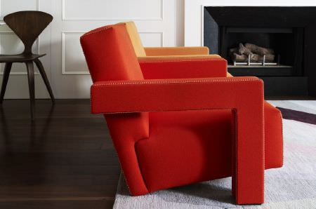 Christopher Farr -  Woven Indoor Fabric Collection - Fiery orange-red sofas with angular armrests, on a white rug, with a plain black moulded chair