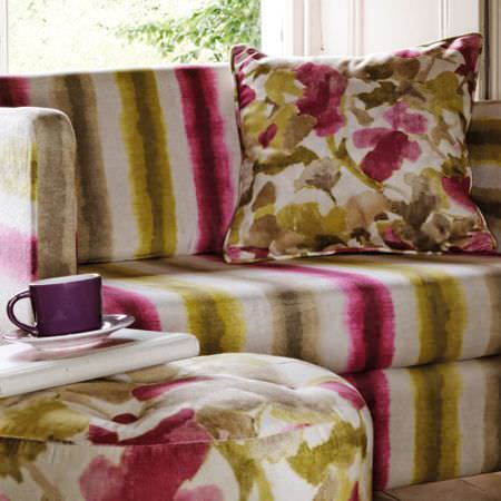 Clarke and Clarke -  Artiste Fabric Collection - Shades of green, pink, beige and white making up a striped sofa, a square scatter cushion and a round footstool