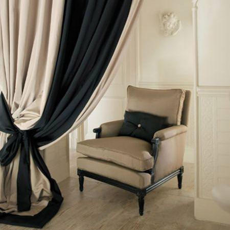 Clarke and Clarke -  Aruba Fabric Collection - Black and neutral fabric curtain with upholstered chair and cushion