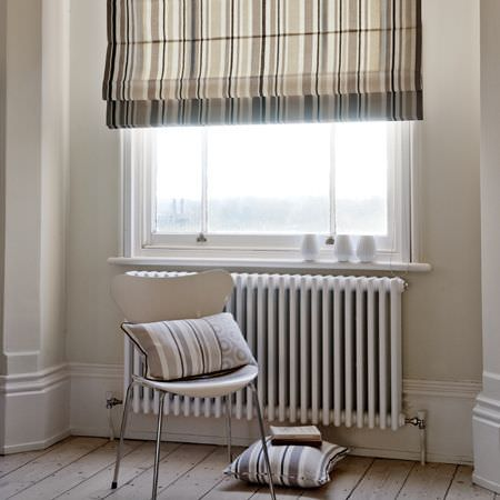 Clarke and Clarke -  Astrid Fabric Collection - A white and beige striped roman blind. and two white and beige striped cushions