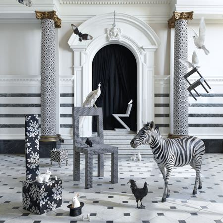 Clarke and Clarke -  Black and White Fabric Collection - Modern black and white decorative patterns on chair, ottoman, pillars, wallpaper and even the floor