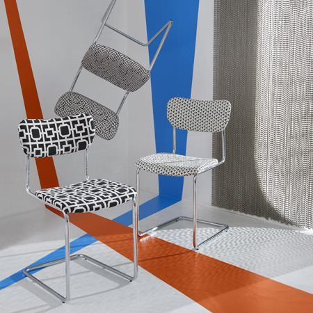 Clarke and Clarke -  Black and White Fabric Collection - A set of three chairs decorated with different modern black and white patterns and a black and white curtain