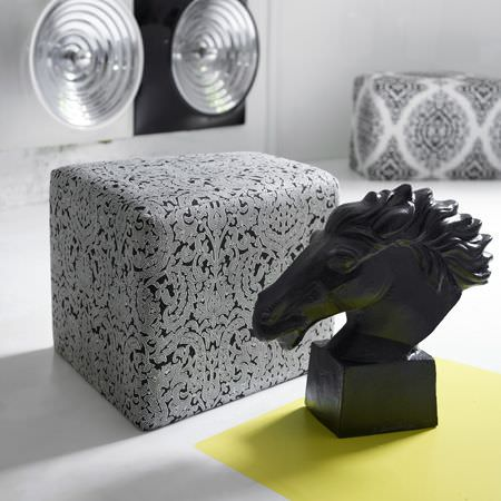 Clarke and Clarke -  Black and White Fabric Collection - Small modern ottoman in black covered with luxurious white floral pattern and a black horse head statue