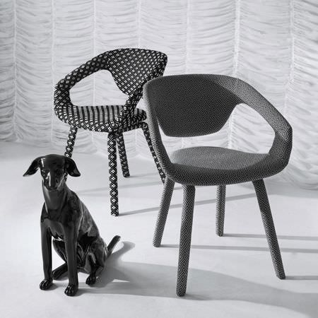 Clarke and Clarke -  Black and White Fabric Collection - Two modern upholstered chairs featuring different interesting black and white decorative designs
