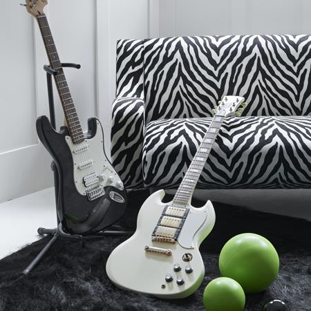 Clarke and Clarke -  Black and White Fabric Collection - Modern shag rug in black and an interesting upholstered sofa featuring black and white zebra pattern