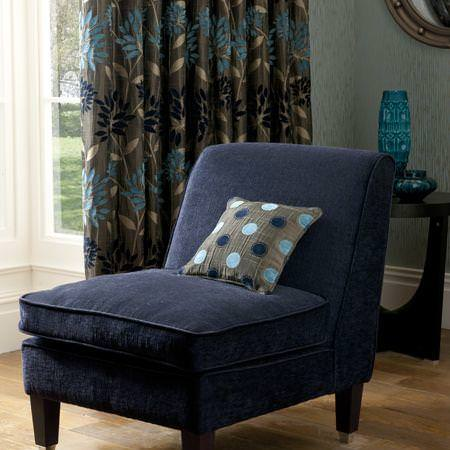 Clarke and Clarke -  Bolero Fabric Collection - Blue and brown floral curtains with blue upholstered chair and dotted cushion