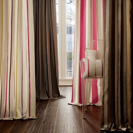 Clarke and Clarke -  Boutique Fabric Collection - White curtain with pink and yellow stripes, a curtain with pink and white bands, and brown and gold striped curtains