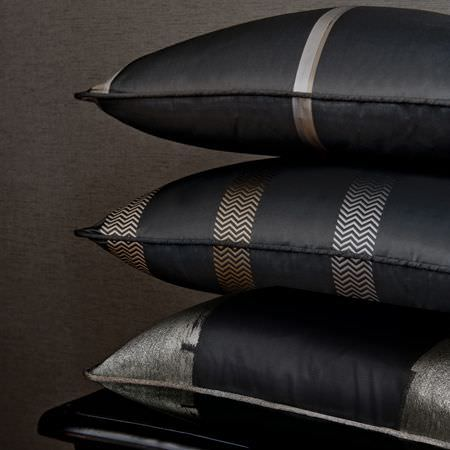 Clarke and Clarke -  Boutique Fabric Collection - Classic black satin cushions decorated with herringbone stripes, and silver bands